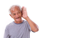 Smiling, happy senior old man listening Stock Photography