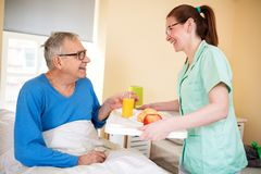 Smiling happy senior patient waiting breakfast at nursing home royalty free stock photos