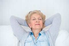 Smiling happy senior woman relaxing Stock Photo