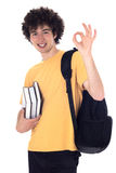 Smiling happy student showing ok sign. Smiling happy student standing with backpack and books and showing ok sign. Isolated on white Stock Images