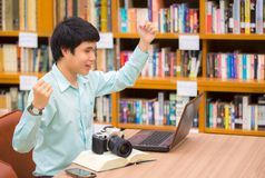 Smiling happy successful student raise arms up celebrating finis Royalty Free Stock Photos