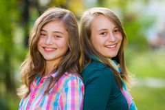 Smiling happy teenager girls having fun. Outdoors Royalty Free Stock Images