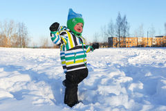 Smiling happy toddler walking in winter Stock Photo