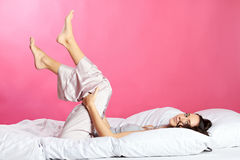Smiling happy woman in bed Stock Photography