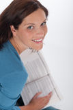 Smiling happy woman with book Stock Image