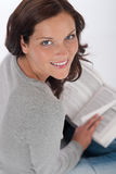 Smiling happy woman with book Royalty Free Stock Images