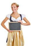 Smiling happy woman with empty blackboard Stock Photography