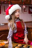 Festive red apron Christmas party dinner dessert peppermint cupcakes cheese cream sugar sprinkling decoration girl new stock photography