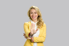 Smiling happy woman gesturing stop. Royalty Free Stock Photo
