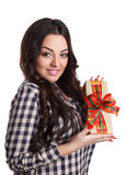 Smiling happy woman holding a gift. Beautiful young woman holding a present isolated on white Royalty Free Stock Photos
