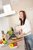 Smiling happy woman in the kitchen Royalty Free Stock Photography