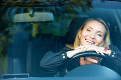 Smiling happy woman in the new car Royalty Free Stock Image