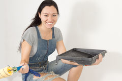 Smiling happy woman with painting equipment Royalty Free Stock Photography