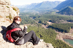 Smiling happy woman on the Rattlesnake Ledge Trail Royalty Free Stock Photo