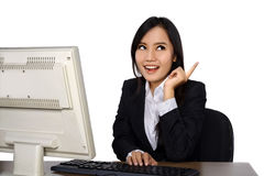 Smiling happy woman using computer Stock Photo