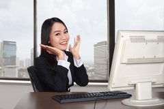Smiling happy woman using computer Royalty Free Stock Images