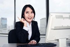 Smiling happy woman using computer Stock Photos