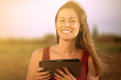 Smiling happy woman using tablet Royalty Free Stock Image