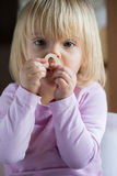 Smiling happy young baby caucasian blonde girl portrait at home Royalty Free Stock Images