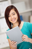 Smiling happy young female Asian student Royalty Free Stock Photography