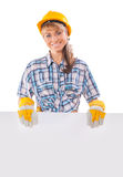 Smiling happy young female construction worker with white placar Stock Images