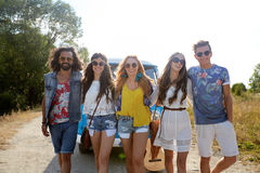 Smiling happy young hippie friends and minivan car Royalty Free Stock Photography