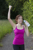 Smiling happy young jogger woman cheering Stock Images