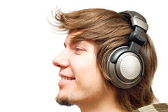 Smiling happy young man in a headphones Royalty Free Stock Photography