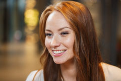 Smiling happy young redhead woman face Royalty Free Stock Photography