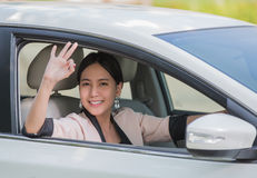 Smiling happy young woman in the car Royalty Free Stock Photos