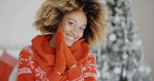 Smiling happy young woman in a Christmas outfit Royalty Free Stock Image