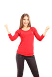 Smiling and happy young woman gesturing happiness Royalty Free Stock Photo