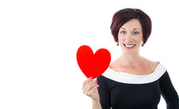 smiling happy young woman holding a heart Stock Photos