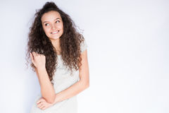 Smiling and happy young woman look at one side with curly hair. Smile happy woman young curls Stock Image