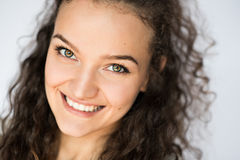 Smiling and happy young woman look at one side with curly hair. Smile happy woman young curls Stock Photography
