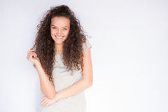 Smiling and happy young woman look at one side with curly hair. Smile happy woman young curls Stock Photos