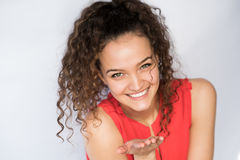 Smiling and happy young woman look at one side with curly hair. Smile happy woman young curls Royalty Free Stock Photos