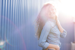 Smiling and happy young woman look at one side with curly hair. Smile happy woman young curls Royalty Free Stock Image