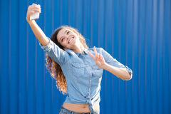 Smiling and happy young woman look at one side with curly hair. Smile happy woman young curls Royalty Free Stock Images