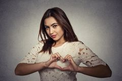 Smiling happy young woman making heart sign with hands Royalty Free Stock Photos