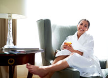 Smiling happy young woman relaxing at home Royalty Free Stock Photo