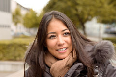 Smiling happy young woman in winter fashion Stock Photography