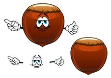 Smiling hazelnut fruit cartoon character Royalty Free Stock Image