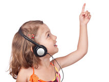 Smiling headphones girl pointing up Royalty Free Stock Images