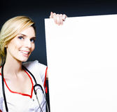 Smiling healthcare professional with a blank board Stock Photo