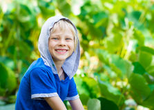 Smiling, healthy child in nature. Portait of a smiling, healthy child out in nature next to a lilly pond royalty free stock photo