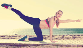 Smiling healthy female stretching muscles Royalty Free Stock Photos