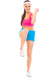 Smiling healthy girl doing fitness exercise Stock Images