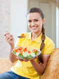 Smiling healthy girl eating veggie salad Stock Photos