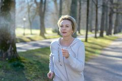 Smiling healthy happy fit senior woman stock images